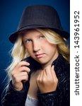 beautiful blonde girl wearing a ... | Shutterstock . vector #143961952