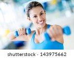 strong woman weightlifting at... | Shutterstock . vector #143975662