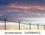 Barbed Wire Fence And Sky