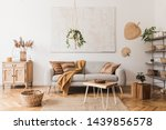 Small photo of The stylish boho compostion at living room interior with design gray sofa, wooden coffee table, commode and elegant personal accessories. Honey yellow pillow and plaid. Cozy apartment. Home decor