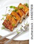 grilled pork on white plate ... | Shutterstock . vector #144007858