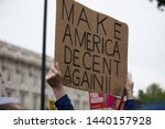 A protestor holds a political...