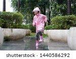 Little Asian Girl Wearing Pink...