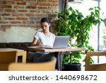 Stock photo young businesswoman is working in a cafeteria in her break woman taking a break enjoying work from 1440698672