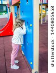 girl plays hide and seek out of ... | Shutterstock . vector #1440805658