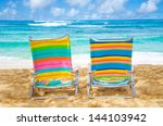 two colorful beach chairs under ... | Shutterstock . vector #144103942