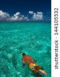 man snorkeling in crystal clear ... | Shutterstock . vector #144105532
