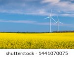 two wind turbines in a rapeseed ... | Shutterstock . vector #1441070075