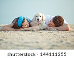 Stock photo couple with their dog 144111355