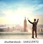 happy businessman standing on... | Shutterstock . vector #144115972