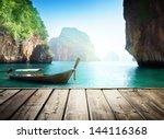 adaman sea and wooden boat in... | Shutterstock . vector #144116368