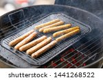 cooking sausages on the... | Shutterstock . vector #1441268522