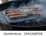 cooking sausages on the... | Shutterstock . vector #1441268528