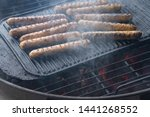 cooking sausages on the... | Shutterstock . vector #1441268552