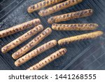 cooking sausages on the... | Shutterstock . vector #1441268555