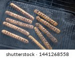 cooking sausages on the... | Shutterstock . vector #1441268558