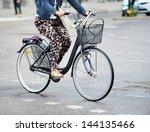 Bike in traffic - stock photo