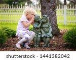 A Cute Little Girl Is Sitting...