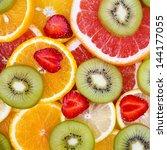 sliced fruits background   Shutterstock . vector #144177055