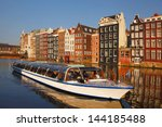 Amsterdam City With Boats On...