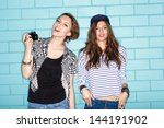 two young naughty girlfriends... | Shutterstock . vector #144191902