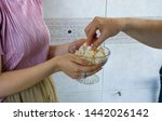 woman holding and offering or... | Shutterstock . vector #1442026142