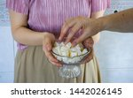 woman holding and offering or... | Shutterstock . vector #1442026145
