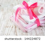 baby  pink apparel on a wooden... | Shutterstock . vector #144224872