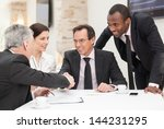 business colleagues sitting at... | Shutterstock . vector #144231295
