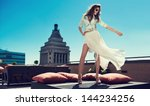 beautiful woman white loose... | Shutterstock . vector #144234256