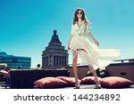 beautiful woman white loose... | Shutterstock . vector #144234892