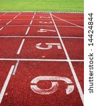 Athletic track with start numbers and lines - stock photo