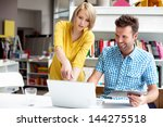 two bookshop managers working... | Shutterstock . vector #144275518