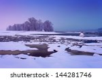winter river with cracked ice... | Shutterstock . vector #144281746