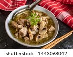 soup with pieces of pork and... | Shutterstock . vector #1443068042