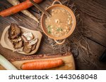 mushroom soup on a wooden table.... | Shutterstock . vector #1443068048