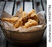Fried Chicken In A Basket On A...