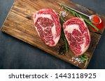 Two Raw Rib Eye Steak On The...