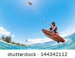kite surfing  fun in the ocean  ... | Shutterstock . vector #144342112