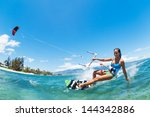 kite boarding  fun in the ocean ... | Shutterstock . vector #144342886