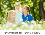 happy mother  father and...   Shutterstock . vector #144344392