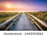 Wooden Pier At Sunset Along Th...