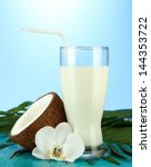 coconut with glass of milk   on ... | Shutterstock . vector #144353722