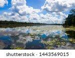Small photo of The lake of Neak Pean. Neak Pean at Angkor, Cambodia is an artificial island with a Buddhist temple on a circular island in Jayatataka Baray