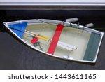 Half Sunken Boat In The Harbour.
