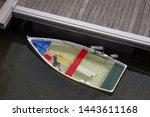 Half Sunken Boat In The Harbou...