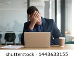 Frustrated upset black business man stressed about computer problem, bad online news financial market crisis, sad desperate african ceo feel loser sit at desk with laptop shocked by bankruptcy debt - stock photo