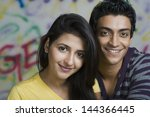 portrait of a couple smiling | Shutterstock . vector #144366445