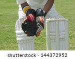 wicket keeper standing behind... | Shutterstock . vector #144372952