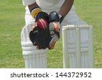 wicket keeper standing behind... | Shutterstock . vector #144372952